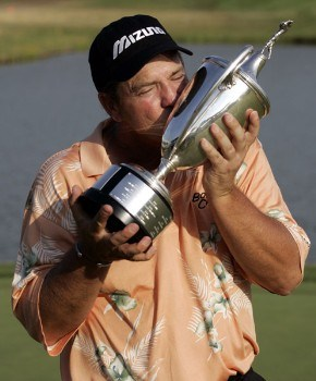 Tom Purtzer kisses the champions trophy after winning the 3M Championship, August 7, 2005, held at the TPC of the Twin Cities, Blaine, Minnesota. Purtzer finished -15 holding off Craig Stadler and Lonnie Nielsen for a one shot victory.Photo by Gregory Shamus/WireImage.com