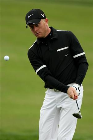PEBBLE BEACH, CA - JUNE 15:  Simon Dyson of England hits a shot during a practice round prior to the start of the 110th U.S. Open at Pebble Beach Golf Links on June 15, 2010 in Pebble Beach, California.  (Photo by Ross Kinnaird/Getty Images)