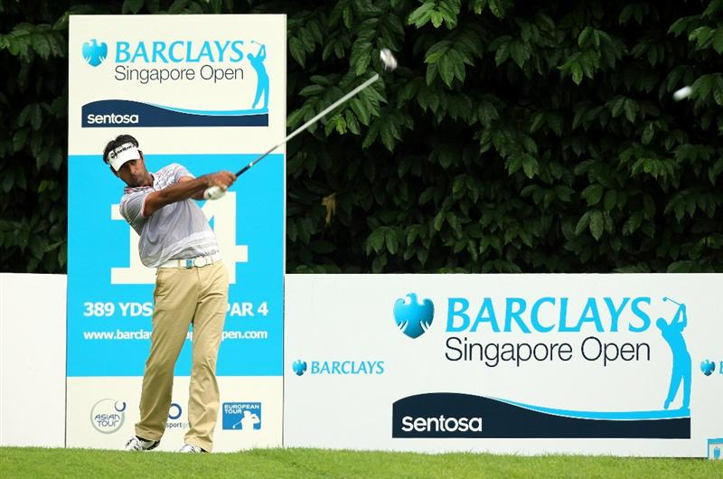 SINGAPORE - NOVEMBER 11: Jyoti Randhawa of India tees off on the 14th hole during the First Round of the Barclays Singapore Open at Sentosa Golf Club on November 11, 2010 in Singapore, Singapore.  (Photo by Stanley Chou/Getty Images)