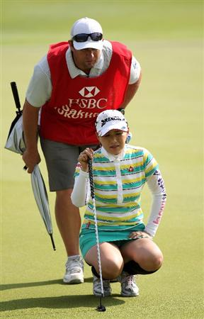 SINGAPORE - FEBRUARY 27:  Sakura Yokomine of  Japan during the third round of the HSBC Women's Champions at the Tanah Merah Country Club on February 27, 2010 in Singapore.  (Photo by Ross Kinnaird/Getty Images)