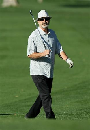 LA QUINTA, CA - JANUARY 20: Drummer Danny Seraphine, founding member of the rock group 'Chicago,' watches a shot during round two of the Bob Hope Classic at the La Quinta Country Club on January 20, 2011 in La Quinta, California. (Photo by Stephen Dunn/Getty Images)