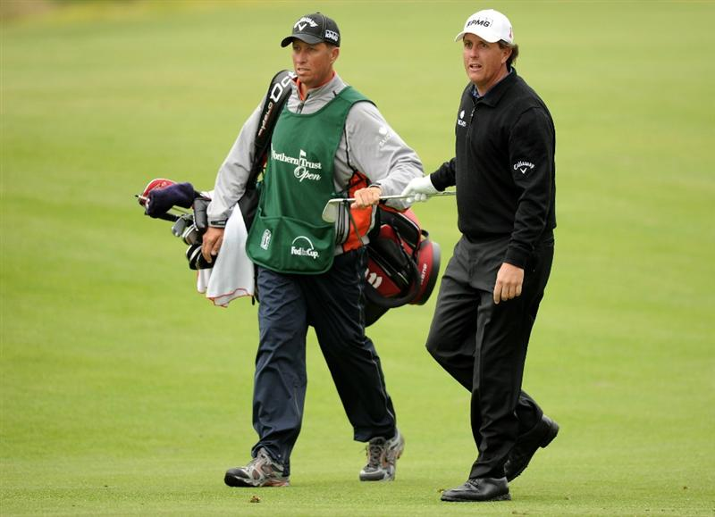 PACIFIC PALISADES, CA - FEBRUARY 18:  Phil Mickelson and caddie Jim MacKay look to the green on the eighth hole during the second round of the Northern Trust Open at the Riviera Country Club on February 18, 2011 in Pacific Palisades, California.  (Photo by Harry How/Getty Images)