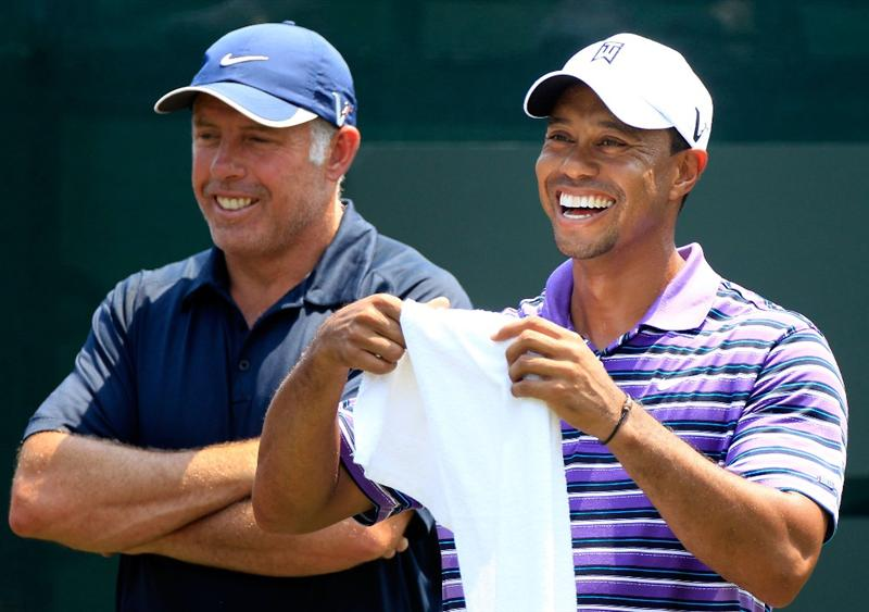 PONTE VEDRA BEACH, FL - MAY 10:  Tiger Woods (R) laughs as he talks with caddie Steve Williams (L) during a practice round prior to the start of THE PLAYERS Championship held at THE PLAYERS Stadium course at TPC Sawgrass on May 10, 2011 in Ponte Vedra Beach, Florida.  (Photo by Sam Greenwood/Getty Images)