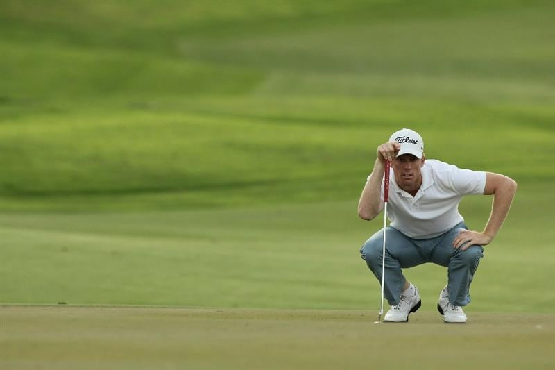 SINGAPORE - NOVEMBER 12:  Andrew Dodt of Australia lines up for a putt on the 12th hole during the second round of the Barclays Singapore Open held at the Sentosa Golf Club on November 12, 2010 in Singapore, Singapore.  (Photo by Stanley Chou/Getty Images)
