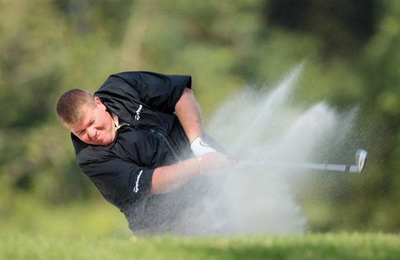HONG KONG, CHINA - NOVEMBER 20:  John Daly of USA plays his bunker shot on the 18th hole during the first round of the UBS Hong Kong Open at the Hong Kong Golf Club on November 20, 2008 in Fanling, Hong Kong.  (Photo by Stuart Franklin/Getty Images)