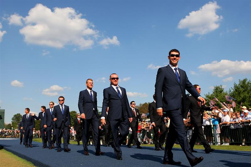 LOUISVILLE, KY - SEPTEMBER 18:  Robert Karlsson, Miguel Angel Jimenez and Padraig Harrington of the European team walks alongside his teammates and the USA team during the opening ceremony for the 2008 Ryder Cup at Valhalla Golf Club on September 18, 2008 in Louisville, Kentucky.  (Photo by Andrew Redington/Getty Images)