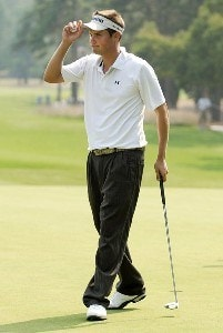 Jeff Overton acknowledges the gallery after sinking a birdie putt on the ninth green during the second round of the Wyndham Championship at Forest Oaks Country Club on August 17, 2007 in Greensboro, North Carolina. PGA TOUR - 2007 Wyndham Championship - Second RoundPhoto by Jonathan Ernst/WireImage.com