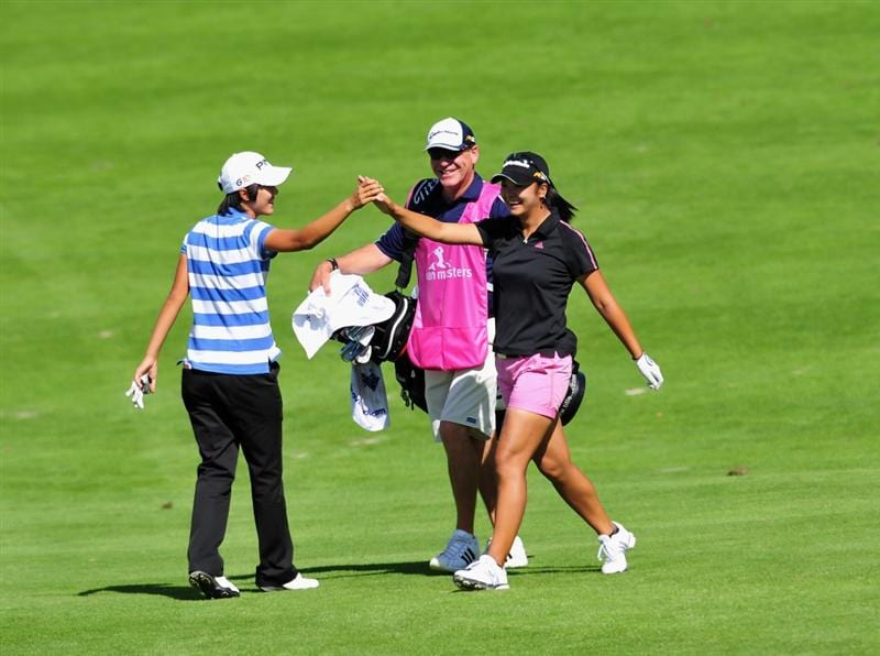 EVIAN-LES-BAINS, FRANCE - JULY 25: Yuko Mitsuka of Japan celebrates after holing her approach shot on the 18th hole with playing partner Song - Hee Kim of South Korea during the third round of the Evian Masters at the Evian Masters Golf Club on July 25, 2009 in Evian-les-Bains, France.  (Photo by Stuart Franklin/Getty Images)