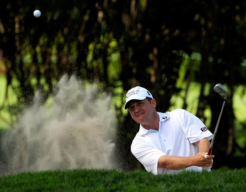 PALM HARBOR, FL - MARCH 19:  Jason Bohn plays a shot from the bunker on the 16th hole during the first round of the Transitions Championship at the Innisbrook Resort and Golf Club on March 19, 2009 in Palm Harbor, Florida.  (Photo by Sam Greenwood/Getty Images)