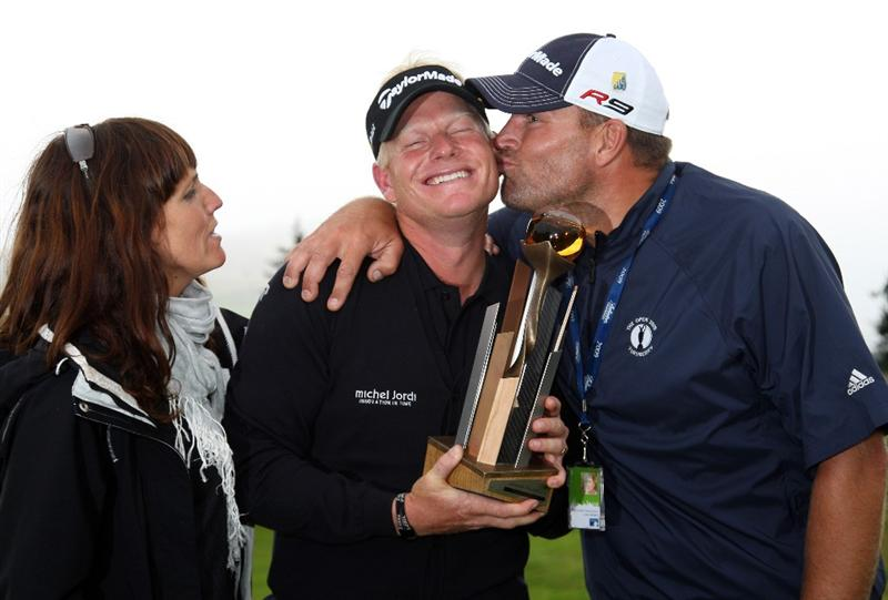 AUCHTERARDER, SCOTLAND - AUGUST 30:  Peter Hedblom of Sweden with his wife Anna and his caddie  with the winners trophy after the final round of the Johnnie Walker Championship on the PGA Centenary Course at Gleneagles on August 30, 2009 in Auchterarder, Scotland.  (Photo by Ross Kinnaird/Getty Images)