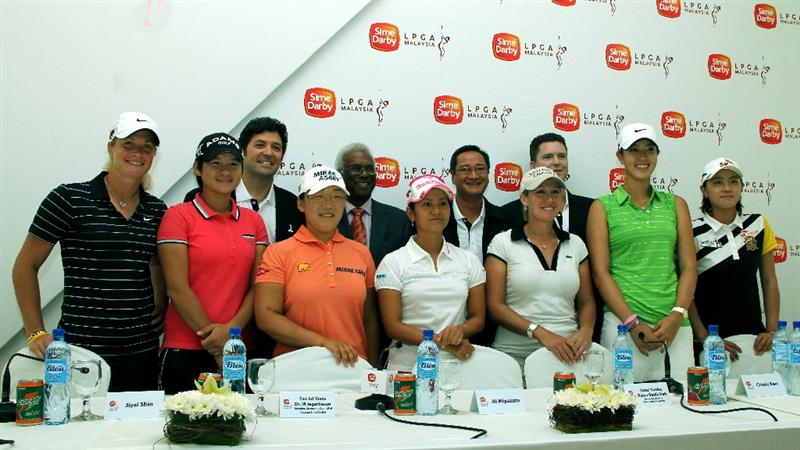 KUALA LUMPUR, MALAYSIA - OCTOBER 20 : LPGA Players and Officials pose for photographs during the Sime Darby LPGA press conference on October 20, 2010 held at the Sime Darby Convention Centre in Kuala Lumpur, Malaysia.  (Photo by Stanley Chou/Getty Images)