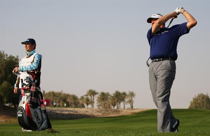 DOHA, QATAR - JANUARY 21:  Colin Montgomerie of Scotland hits his second shot on the sixth hole during the Pro Am for the Commercialbank Qatar Masters at Doha Golf Club on January 21, 2009 in Doha, Qatar.  (Photo by Andrew Redington/Getty Images)