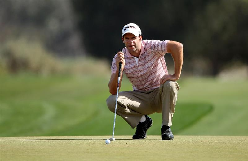 DOHA, QATAR - JANUARY 30:  Bradley Dredge of Wales lines up a putt on the fourth hole during the third round of the Commercialbank Qatar Masters at Doha Golf Club on January 30, 2010 in Doha, Qatar.  (Photo by Andrew Redington/Getty Images)