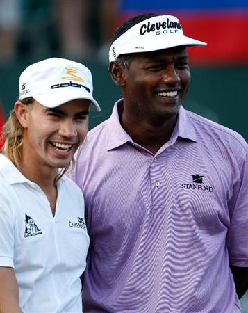ATLANTA - SEPTEMBER 28:  Camilo Villegas (L) of Colombia and Vijay Singh (R) of Fiji smile during the final round of THE TOUR Championship presented by Coca-Cola, at East Lake Golf Club on September 28, 2008 in Atlanta, Georgia. This is the final event of the PGA TOUR Playoffs for the FedExCup.  (Photo by Streeter Lecka/Getty Images)