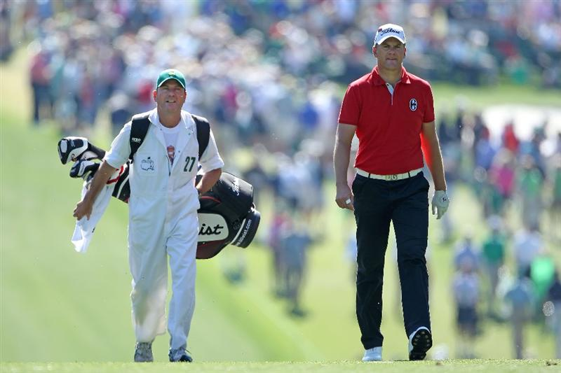 AUGUSTA, GA - APRIL 07:  Robert Karlsson of Sweden walks with his caddie Alastair McLean on the first hole during the first round of the 2011 Masters Tournament at Augusta National Golf Club on April 7, 2011 in Augusta, Georgia.  (Photo by Andrew Redington/Getty Images)