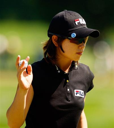 BETHLEHEM, PA - JULY 12:  Eun Hee Ji of South Korea waves to the gallery on the ninth hole during the final round of the 2009 U.S. Women's Open at the Saucon Valley Country Club on July 12, 2009 in Bethlehem, Pennsylvania.  (Photo by Scott Halleran/Getty Images)