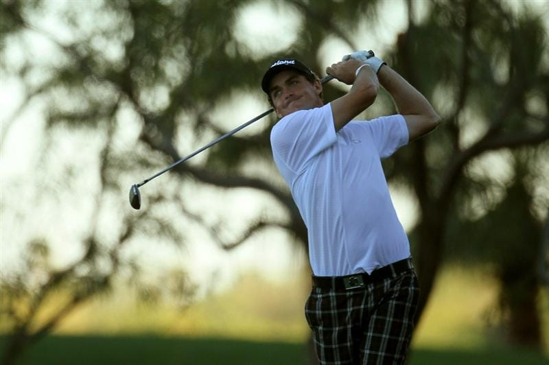 LA QUINTA, CA - JANUARY 22:  Keegan Bradley hits his tee shot on the 16th hole during round four of the Bob Hope Classic at Silver Rock Resort on January 22, 2011 in La Quinta, California. (Photo by Stephen Dunn/Getty Images)