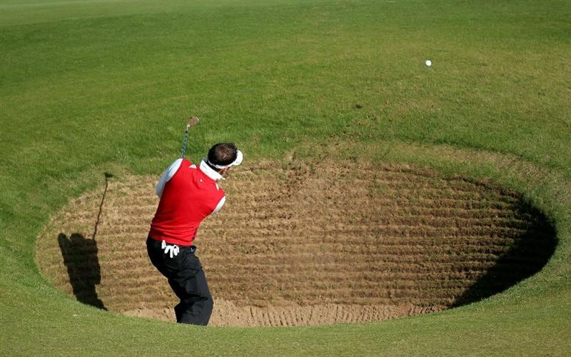 KINGSBARNS, SCOTLAND - OCTOBER 07:  Nick Dougherty of England plays out from the bunker on the first hole during the first round of The Alfred Dunhill Links Championship at Kingsbarns Golf Links on October 7, 2010 in Kingsbarns, Scotland.  (Photo by Ross Kinnaird/Getty Images)