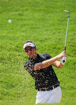 AKRON, OH - JULY 29:  Ian Poulter of England plays a bunker shot during practice for the World Golf Championship Bridgestone Invitational on July 29, 2008 at Firestone Country Club in Akron, Ohio.  (Photo by Stuart Franklin/Getty Images)