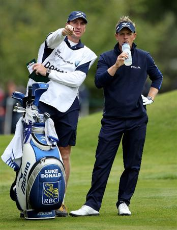 VIRGINIA WATER, ENGLAND - MAY 27:  Luke Donald of England waits with his caddie John McLaren during the second round of the BMW PGA Championship at the Wentworth Club on May 27, 2011 in Virginia Water, England.  (Photo by Warren Little/Getty Images)