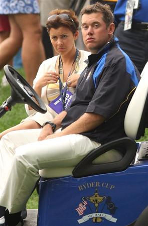 LOUISVILLE, KY - SEPTEMBER 20:  Lee Westwood of the European team waits with his wife Laurae in a golf cart during the morning foursome matches on day two of the 2008 Ryder Cup at Valhalla Golf Club on September 20, 2008 in Louisville, Kentucky.  (Photo by Ross Kinnaird/Getty Images)
