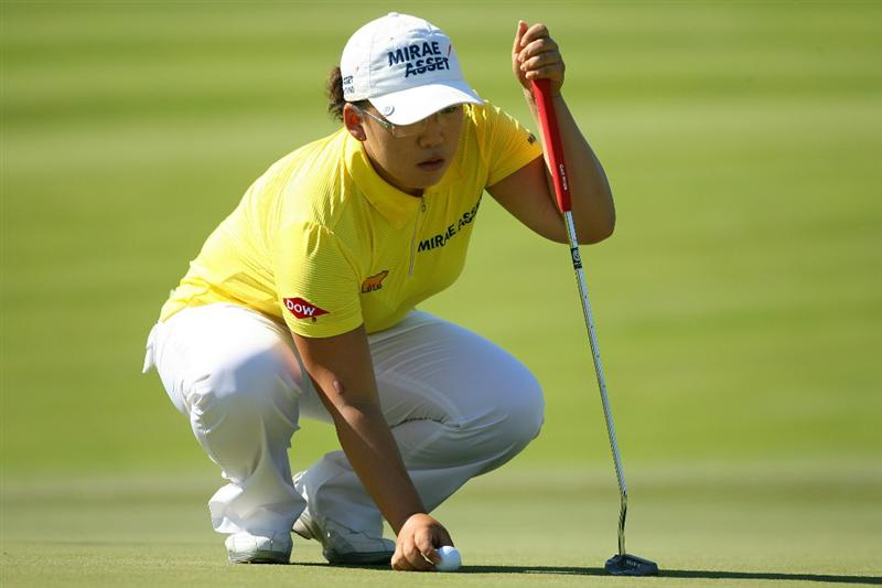 GLADSTONE, NJ - MAY 20 : Jiyai Shin of South Korea lines up her birdie putt on the 15th hole during the first round of the Sybase Match Play Championship at Hamilton Farm Golf Club on May 20, 2010 in Gladstone, New Jersey. (Photo by Hunter Martin/Getty Images)