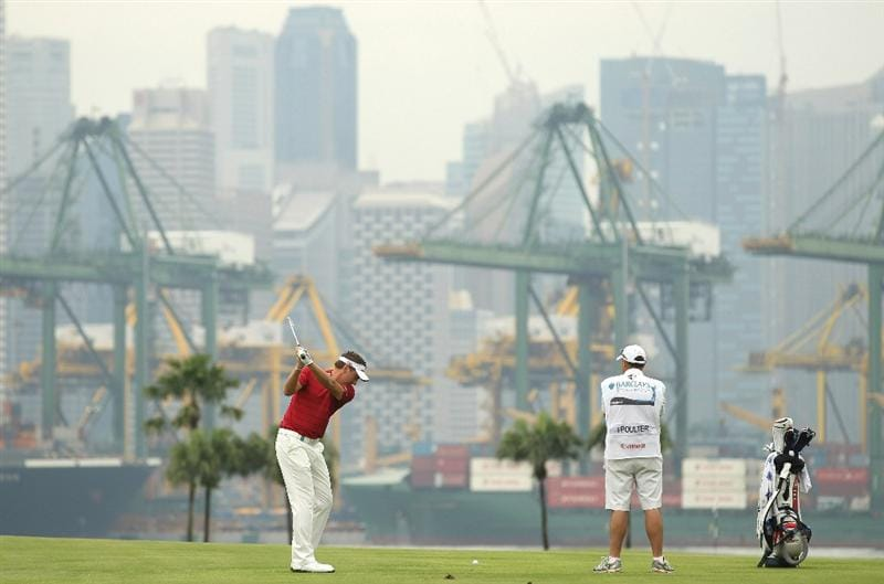 SINGAPORE - NOVEMBER 13:  Ian Poulter of England in action during the Final Round of the Barclays Singapore Open at Sentosa Golf Club on November 14, 2010 in Singapore, Singapore.  (Photo by Ian Walton/Getty Images)
