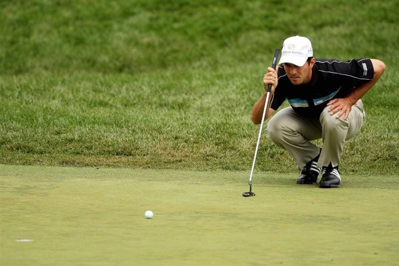 FARMINGDALE, NY - JUNE Mike Weir of Canada lines up a putt on the sixth green during the continuation of the final round of the 109th U.S. Open on the Black Course at Bethpage State Park on June 22, 2009 in Farmingdale, New York.  (Photo by Andrew Redington/Getty Images)