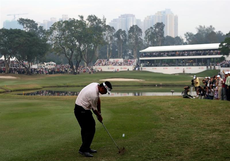 HONG KONG, CHINA - NOVEMBER 23:  Lin Wen-Tang of Chinese Taipei plays his approach shot on the 18th hole during the final round of the UBS Hong Kong Open at the Hong Kong Golf Club on November 23, 2008 in Fanling, Hong Kong.  (Photo by Stuart Franklin/Getty Images)