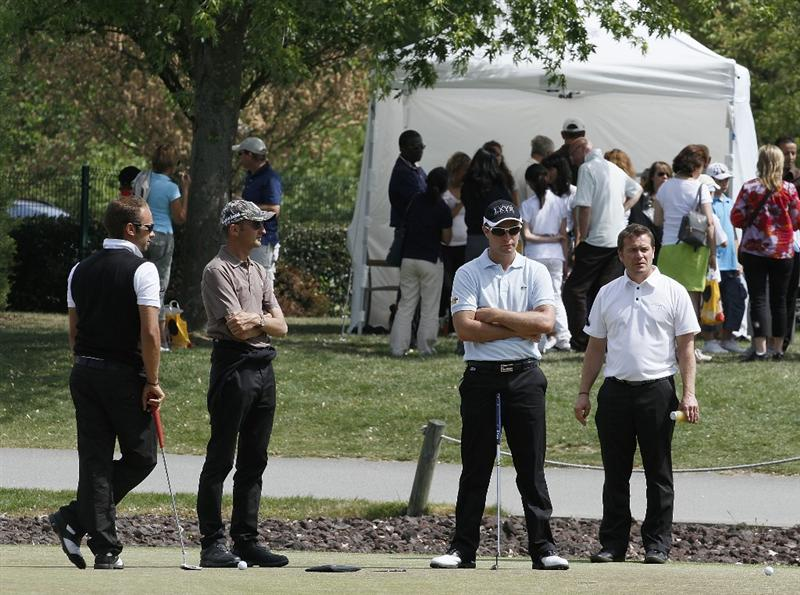 PARIS, FRANCE - MAY 07:  Players and spectators gather for a minutes silence in respect of death of Severiano Ballesteros during the third round of the Allianz Challenge de France played at Golf Disneyland at Disneyland Paris on May 7, 2011 in Paris, France.  (Photo by Phil Inglis/Getty Images)