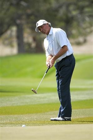 PARKER, CO - MAY 27:   Fred Couples putts for a birdie on the 16th hole during the first round of the Senior PGA Championship at the Colorado Golf Club  on May 27, 2010 in Parker, Colorado.  (Photo by Marc Feldman/Getty Images)