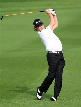 BAHRAIN, BAHRAIN - JANUARY 27:  Miguel Angel Jimenez of Spain plays his second shot at the 14th hole during the first round of the 2011 Volvo Champions held at the Royal Golf Club on January 27, 2011 in Bahrain, Bahrain.  (Photo by David Cannon/Getty Images)