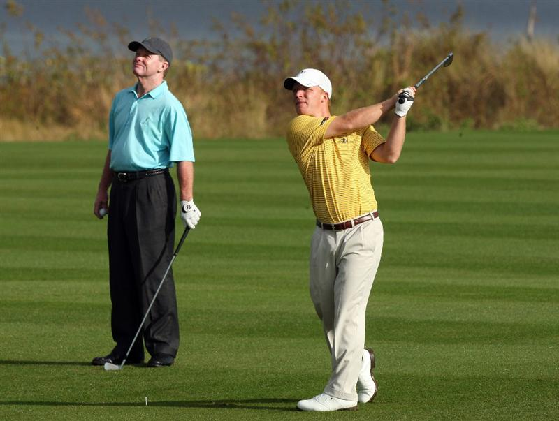 CHAMPIONS GATE, FL - DECEMBER 06: Tom Kite of the USA watches his son David Kite hit his second shot at the the 1st hole during the first round of the Del Webb Father Son Challenge on the International Course at Champions Gate Golf Club on December 6, 2008 in Champions Gate, Florida.  (Photo by David Cannon/Getty Images)