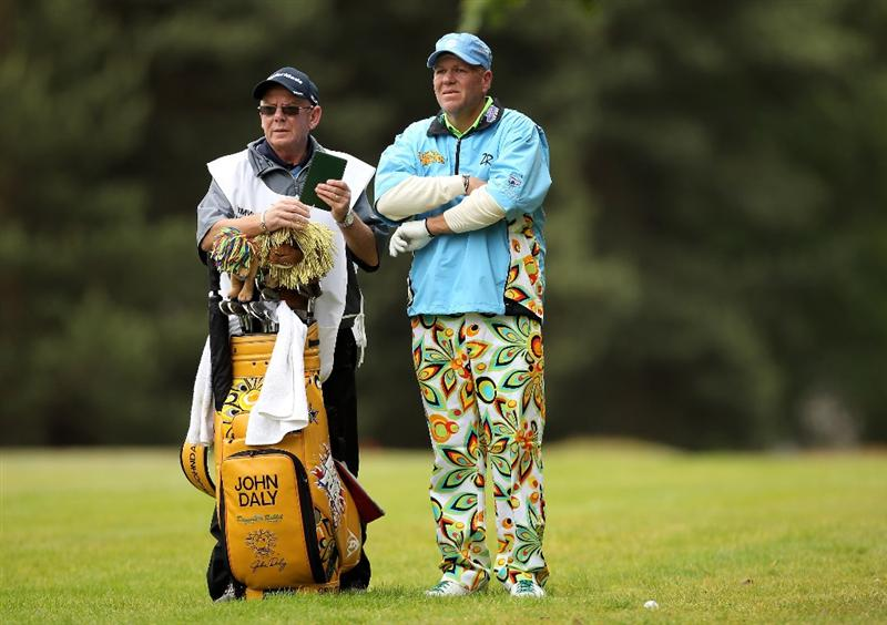 VIRGINIA WATER, ENGLAND - MAY 27:  John Daly of the USA lines up a shot with his caddie during the second round of the BMW PGA Championship at the Wentworth Club on May 27, 2011 in Virginia Water, England.  (Photo by Ian Walton/Getty Images)