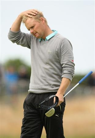TURNBERRY, SCOTLAND - JULY 17:  Soren Kjeldsen of Denmark reacts to a putt during round two of the 138th Open Championship on the Ailsa Course, Turnberry Golf Club on July 17, 2009 in Turnberry, Scotland.  (Photo by Ross Kinnaird/Getty Images)