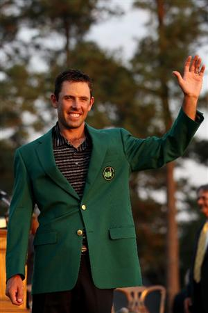 AUGUSTA, GA - APRIL 10:  Charl Schwartzel of South Africa waves to the gallery at the green jacket presentation after his two-stroke victory at the 2011 Masters Tournament at Augusta National Golf Club on April 10, 2011 in Augusta, Georgia.  (Photo by Andrew Redington/Getty Images)