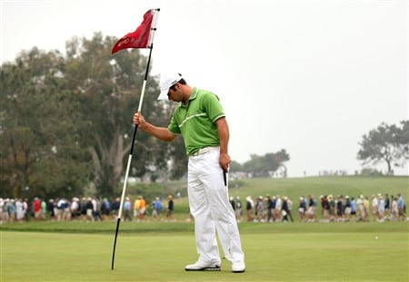 SAN DIEGO - JUNE 14:  Paul Casey of England replaces the flag stick on the fourth green during the third round of the 108th U.S. Open at the Torrey Pines Golf Course (South Course) on June 14, 2008 in San Diego, California.  (Photo by Ross Kinnaird/Getty Images)