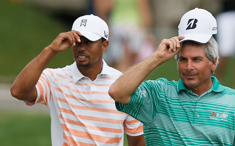Tiger Woods (L) and Fred Couples