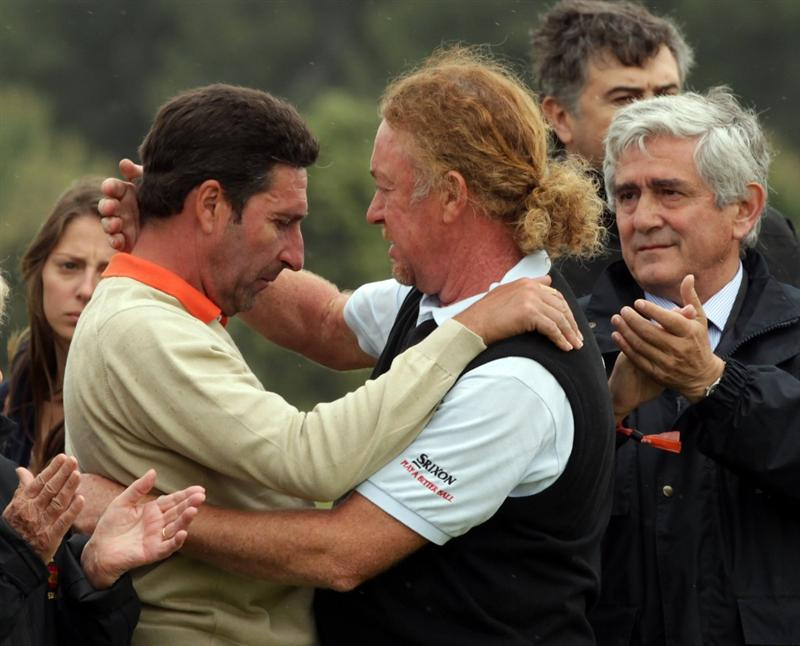 BARCELONA, SPAIN - MAY 07:  Jose Maria Olazabal of Spain and Miguel Angel Jimenez of Spain after the minute silence held in memory of Seve Ballesteros during the third round of the Open de Espana at the the Real Club de Golf El Prat on May 7 , 2011 in Barcelona, Spain.  (Photo by Ross Kinnaird/Getty Images) *** BESTPIX ***