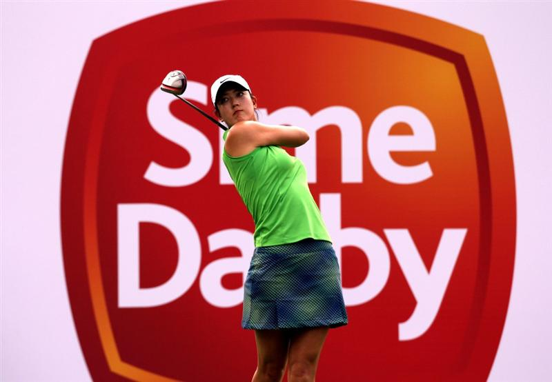 KUALA LUMPUR, MALAYSIA - OCTOBER 21:  Michelle Wie of USA watches her tee  shot on the 9th hole during the Sime Darby Pro-Am at the KLGCC Golf Course on October 21, 2010 in Kuala Lumpur, Malaysia.  (Photo by Stanley Chou/Getty Images)