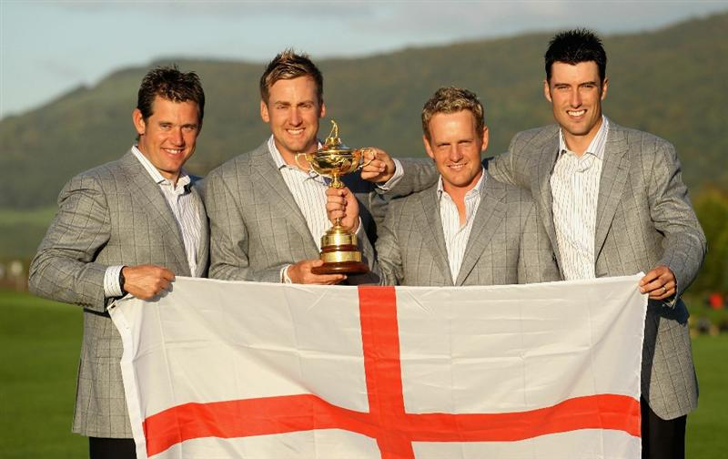 NEWPORT, WALES - OCTOBER 04:  European Team members (L-R) Lee Westwood, Ian Poulter, Luke Donald and Ross Fisher pose with the Ryder Cup following Europe's 14.5 to 13.5 victory over the USA at the 2010 Ryder Cup at the Celtic Manor Resort on October 4, 2010 in Newport, Wales.  (Photo by Andy Lyons/Getty Images)