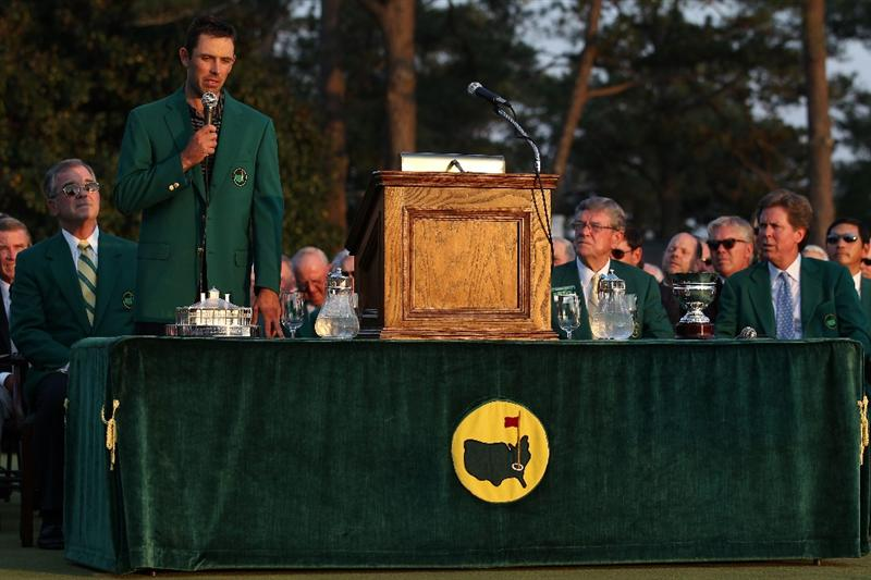 AUGUSTA, GA - APRIL 10:  Charl Schwartzel of South Africa speaks to the gallery at the green jacket presentation as William Porter Payne, Hootie Johnson and Fred Ridley look on after his two-stroke victory at the 2011 Masters Tournament at Augusta National Golf Club on April 10, 2011 in Augusta, Georgia.  (Photo by Andrew Redington/Getty Images)