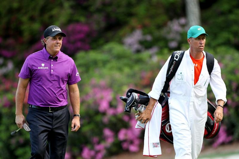 AUGUSTA, GA - APRIL 07:  Phil Mickelson and caddie Jim 'Bones' Mackay walk to the green on the 13th hole during the first round of the 2011 Masters Tournament at Augusta National Golf Club on April 7, 2011 in Augusta, Georgia.  (Photo by Andrew Redington/Getty Images)