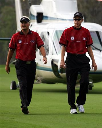 ORLANDO, FL - MARCH 16:  Daniel Chopra (L) and Nick O'Hern arrive by helicoptor for the Tavistock Cup on March 16, 2009 at Lake Nona Country Club in Orlando, Florida.  (Photo by Marc Serota/Getty Images)