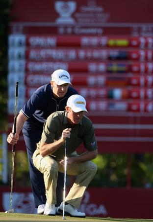 SHENZHEN, CHINA - NOVEMBER 29:  Richard Green and Brendan Jones of Australia line up a putt on the 17th hole during the third round of the Omega Mission Hills world cup on November 29, 2008 in Shenzhen, China.  (Photo by Stuart Franklin/Getty Images)