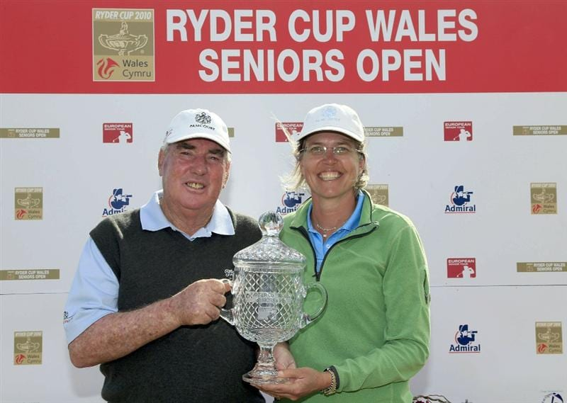 PORTHCAWL, WALES - JUNE 20:  John Bland of South Africa and his wife Sonja pose with the trophy after the final round of the Ryder Cup Wales Seniors Open played at Royal Porthcawl Golf Club on June 20, 2010 in Porthcawl, Wales.  (Photo by Phil Inglis/Getty Images)