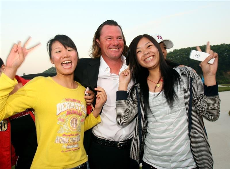 SHENZHEN, CHINA - NOVEMBER 26:  Alex Cejka of Germany is greeted by local chinese golf fans after the opening cermony of the Omega Mission Hills World Cup at the Mission Hills Resort on November 26, 2008 in Shenzhen, China.  (Photo by Stuart Franklin/Getty Images)