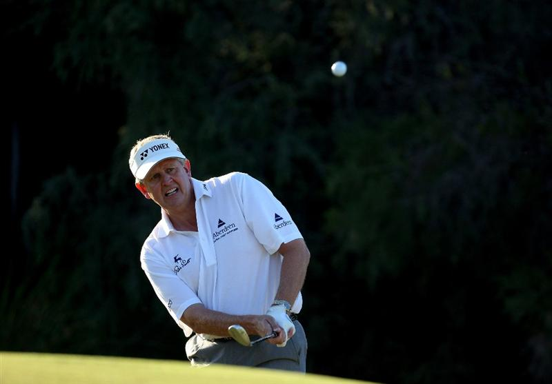 PERTH, AUSTRALIA - FEBRUARY 20:  Colin Montgomerie of Scotland plays his third shot at the 10th hole during the second round of the 2009 Johnnie Walker Classic tournament at the Vines Resort and Country Club, on February 20, 2009, in Perth, Australia  (Photo by David Cannon/Getty Images)