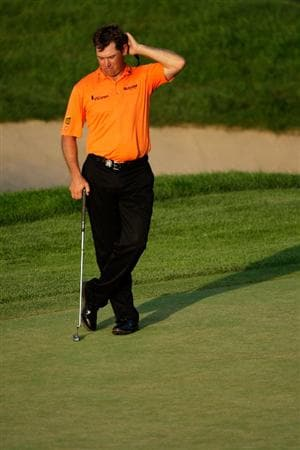 CHASKA, MN - AUGUST 14:  Lee Westwood of England waits on the 18th green during the second round of the 91st PGA Championship at Hazeltine National Golf Club on August 14, 2009 in Chaska, Minnesota.  (Photo by Jamie Squire/Getty Images)