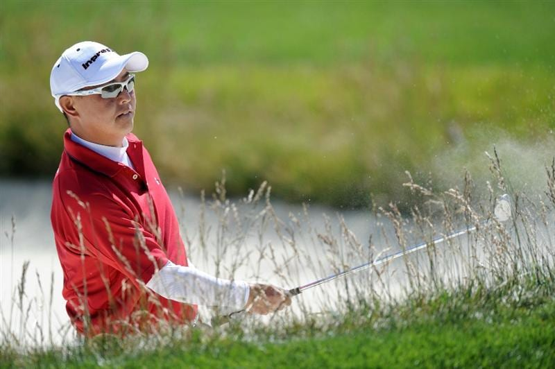 PEBBLE BEACH, CA - JUNE 16:  Toru Taniguchi of Japan hits a bunker shot during a practice round prior to the start of the 110th U.S. Open at Pebble Beach Golf Links on June 16, 2010 in Pebble Beach, California.  (Photo by Harry How/Getty Images)